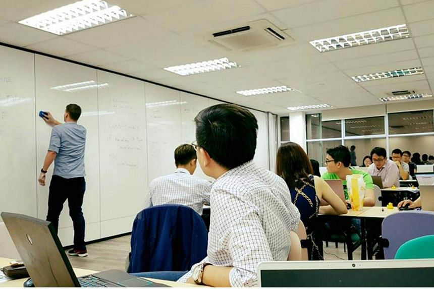 Students attending a programming class at Byte Academy Singapore in December 2016.