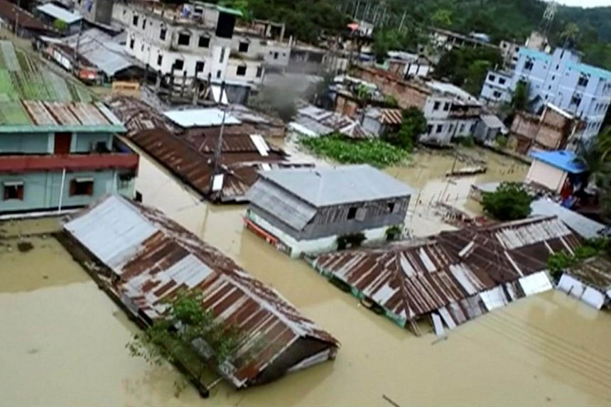 An aerial view showing the town half-submerged in floodwaters following landslides triggered by heavy rain in Khagrachari, Bangladesh, in this still frame taken from video on June 13, 2017.