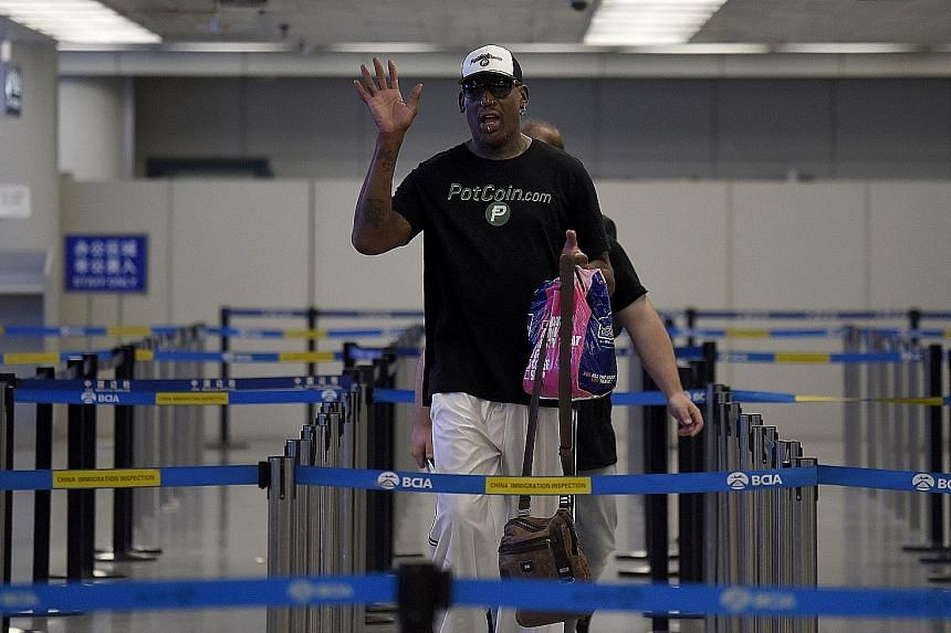 Former NBA basketball player Dennis Rodman preparing to check in for his flight to North Korea at Beijing's international airport yesterday. The flamboyant star has made at least four previous visits to Pyongyang, most recently in 2014.