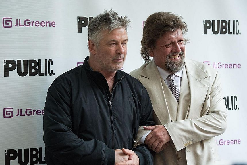 Directed by Oskar Eustis (left, with actor Alec Baldwin on the opening night earlier this week), Julius Caesar (above) sees the title character as a blond businessman who is styled to suggest Mr Donald Trump.