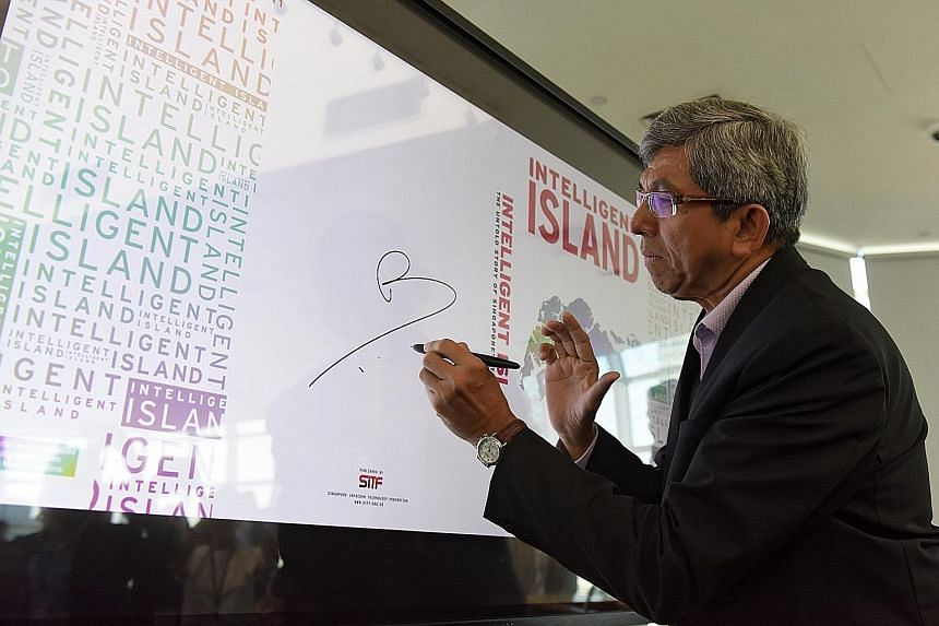 Dr Yaacob Ibrahim, Minister for Communications and Information, signing an interactive screen to launch the book.