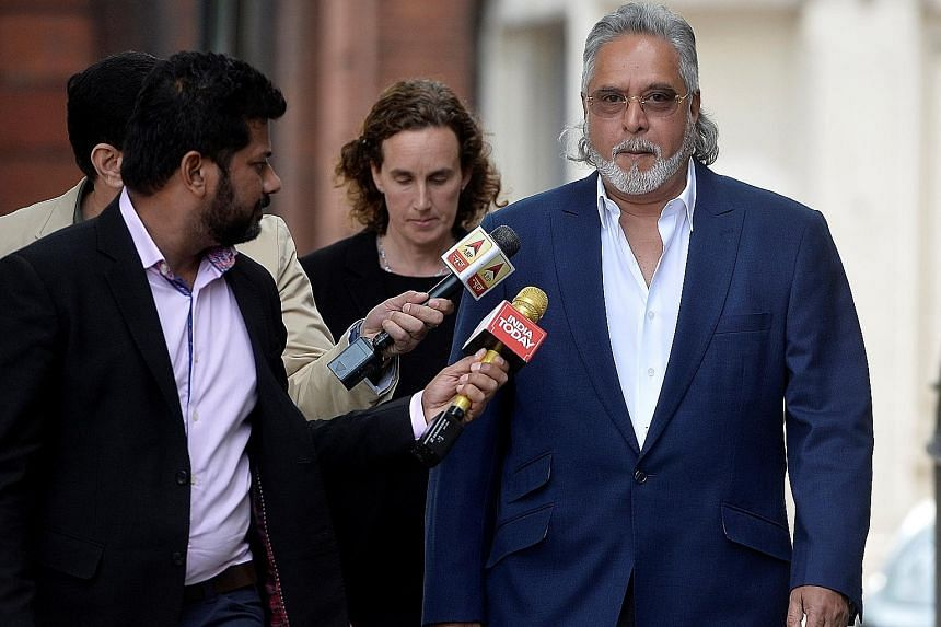 Mr Vijay Mallya arriving for an extradition hearing at a London court yesterday. He fled India last year owing more than S$1.38 billion after defaulting on loan payments to state-owned banks.