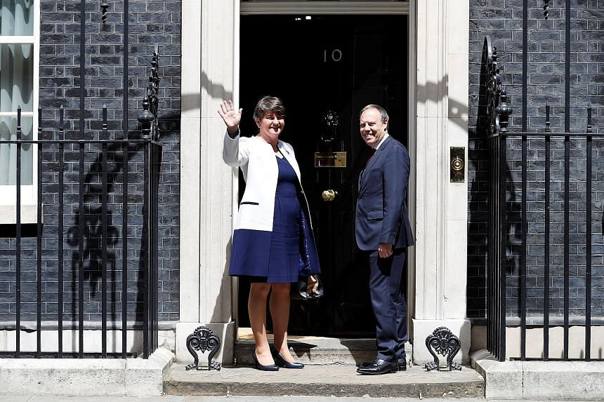 DUP leader Arlene Foster and deputy leader Nigel Dodds on the steps of 10 Downing Street before heading in for talks with Britain's Prime Minister Theresa May. Mrs May is counting on the DUP, with 10 MPs, to support her Conservative government.