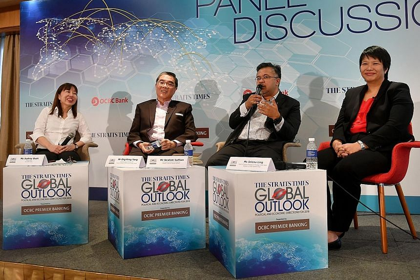 (From left) The Straits Times foreign editor and forum moderator Audrey Quek, Singapore's Ambassador-at-Large Ong Keng Yong, Merdeka Centre director Ibrahim Suffian and OCBC Bank head of Treasury Research and Strategy Selena Ling at yesterday's panel