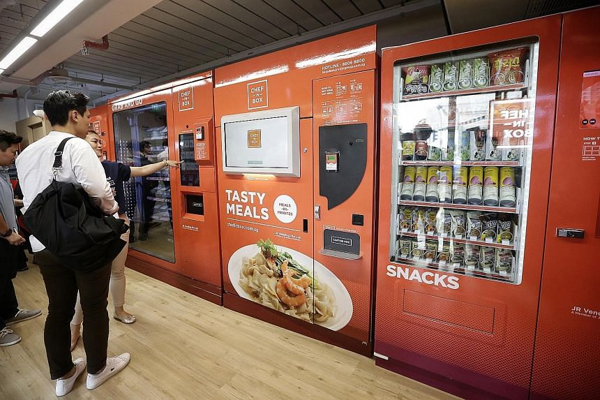 Commuters needing a bite can pick from a wide range of items (below) including soups, cake, wraps and rice dishes from the vending machines at Ang Mo Kio MRT station (left).