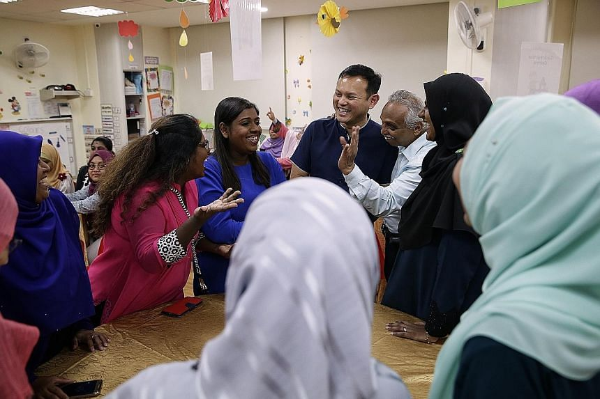 Chua Chu Kang GRC MP Zaqy Mohamad (in blue) with Mr Haja Maideen, executive director of Little Dolphins Playskool, and his pre-school teachers at an iftar session at PCF Sparkletots Preschool in Keat Hong Close yesterday. Mr Zaqy said it was unfair t