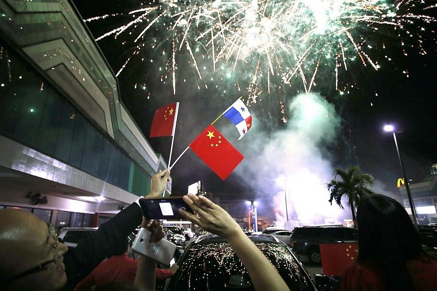 Fireworks seen over the skies on Monday night in Panama City, the capital of Panama, where the Chinese community celebrated news of the establishment of formal diplomatic ties between China and Panama.