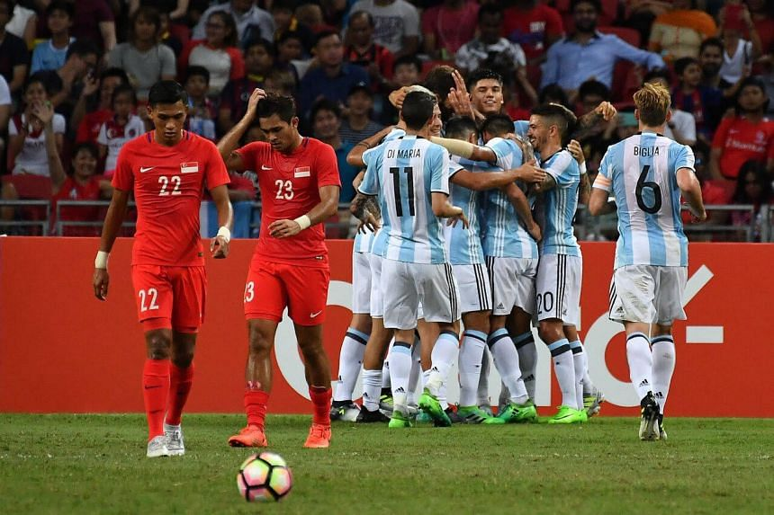 Argentina players celebrating the breakthrough goal after 25 minutes against Singapore in last night's football friendly at the National Stadium. Despite the absence of stars like Lionel Messi and Gonzalo Higuain, the No. 2-ranked team in the world p
