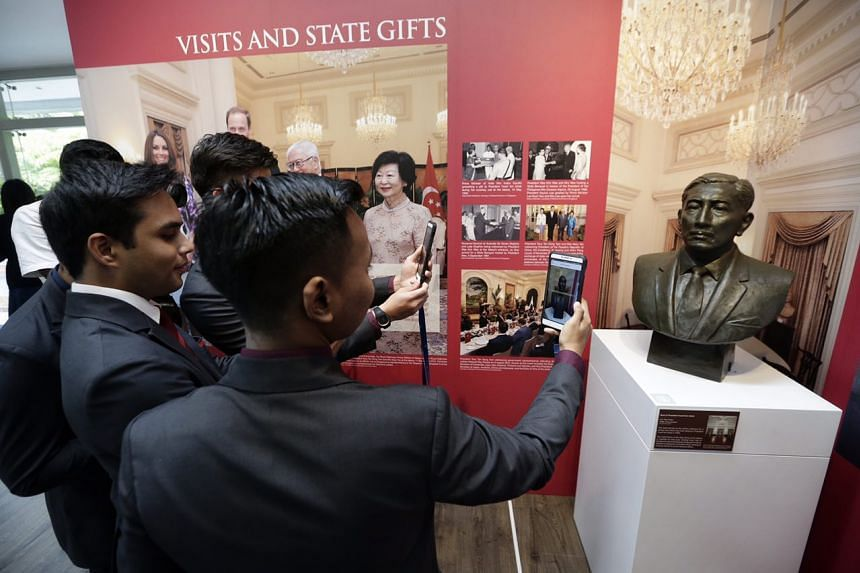 Temasek Poly students scanning a bust of former President Yusof Ishak at the Istana Heritage Gallery Trail, on June 14, 2017.