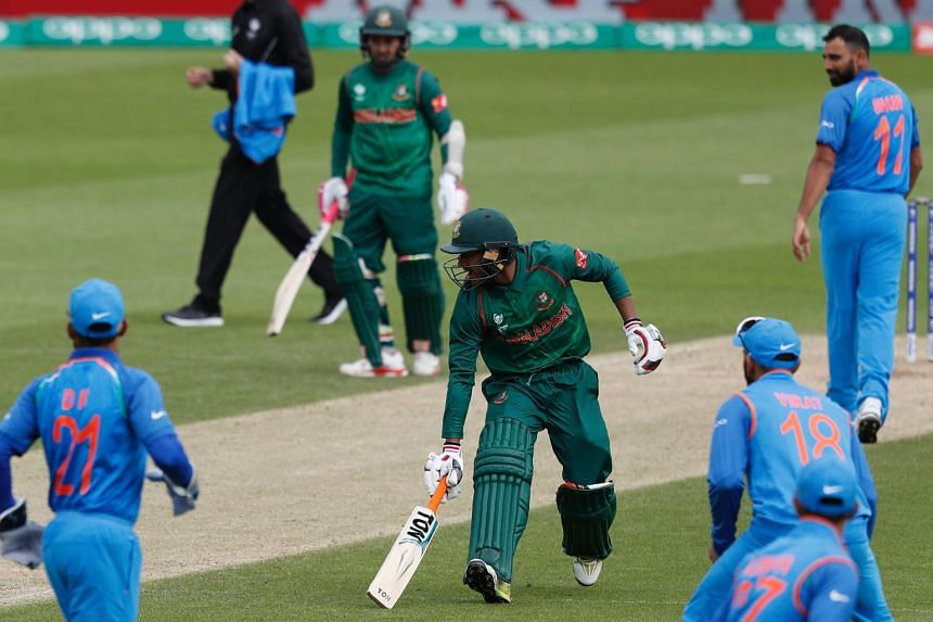Bangladesh's Mehedi Hasan Miraz (Center) returns to his crease during the ICC Champions Trophy Warm-up cricket match between India and Bangladesh at The Oval in London, on May 30, 2017.