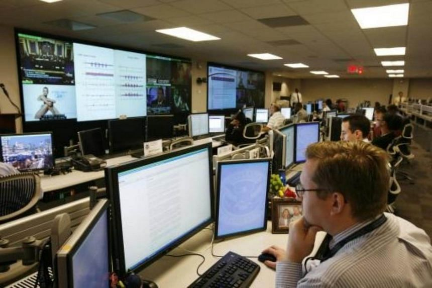 File photo of US Department of Homeland Security analysts working at the National Cybersecurity & Communications Integration Center in Arlington.