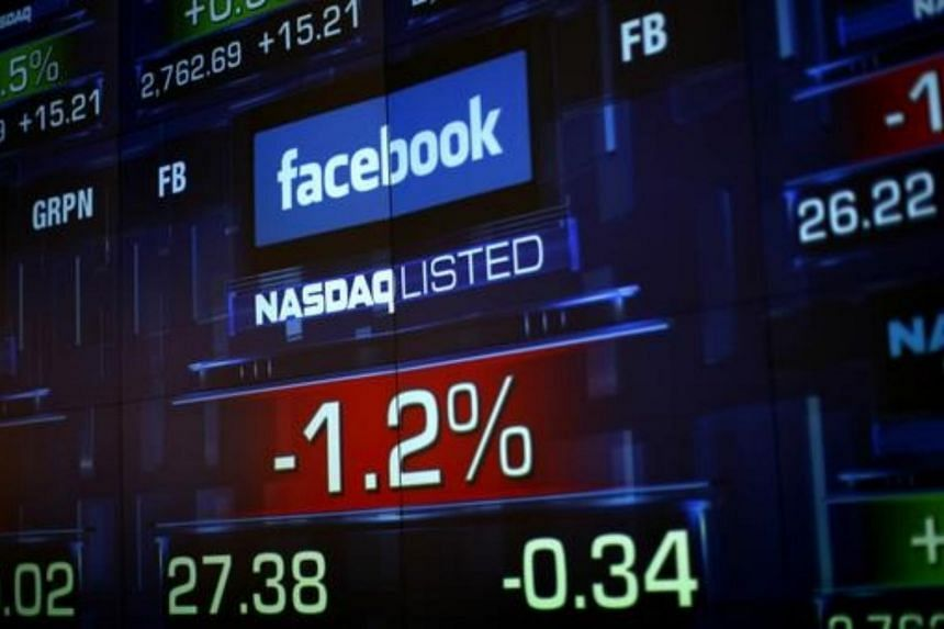Monitors show the value of the Facebook, Inc. stock during morning trading at the NASDAQ Marketsite in New York, on June 4, 2012.
