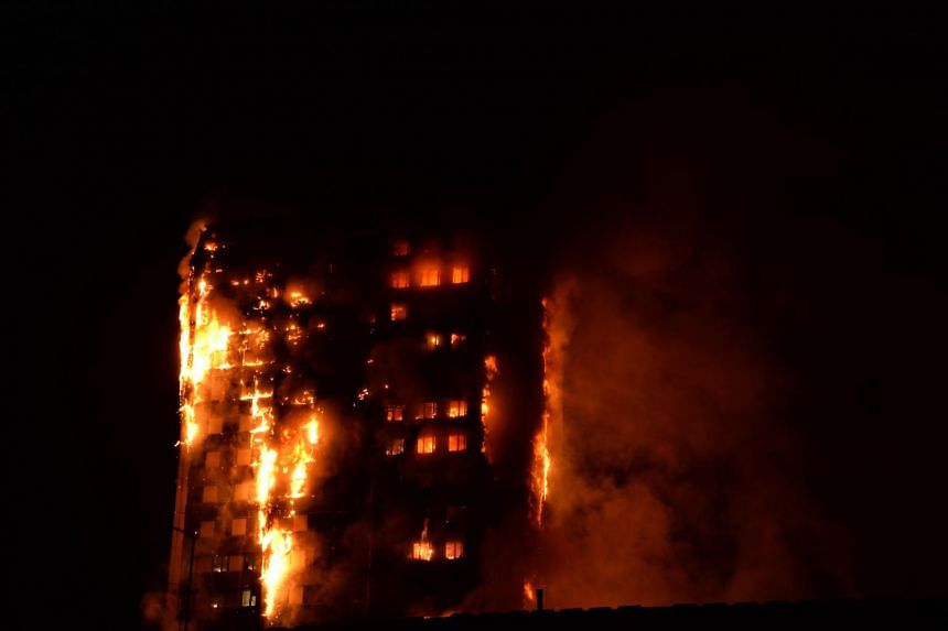 Flames engulfing a block of flats in west London, on June 14, 2017.