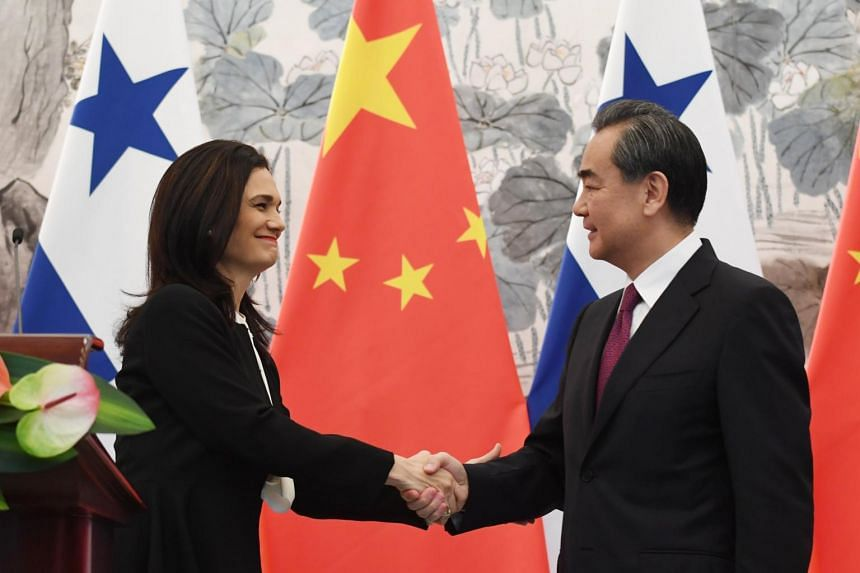 Panama's Foreign Minister Isabel de Saint Malo (left) shaking hands with Chinese Foreign Minister Wang Yi during a joint press briefing in Beijing, China, on June 13, 2017.