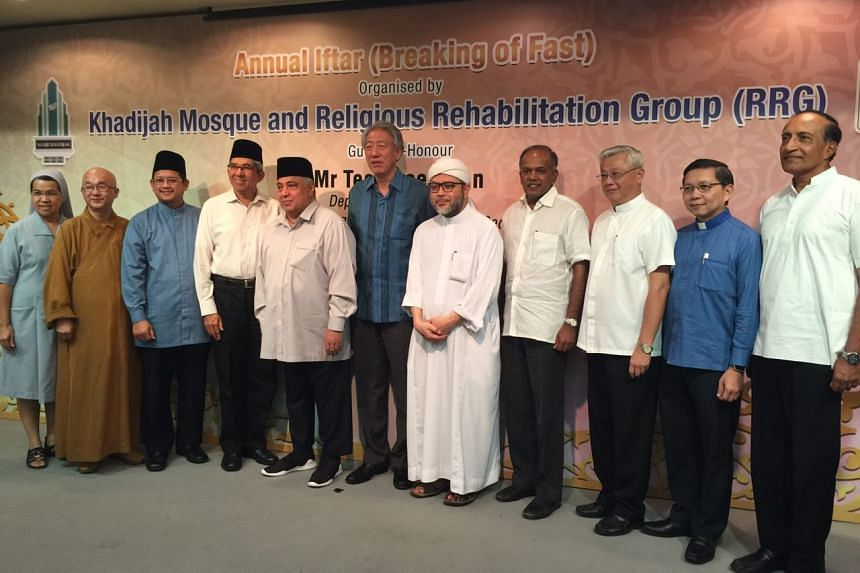 Acting Prime Minister Teo Chee Hean with community and religious leaders from different faiths at an iftar organised by the Religious Rehabilitation Group on June 14, 2017.