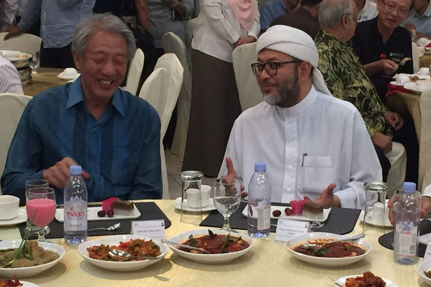 Acting Prime Minister Teo Chee Hean shares a meal with Ustaz Mohamad Hasbi Hassan, president of the Singapore Islamic Scholars & Religious Teachers Association.