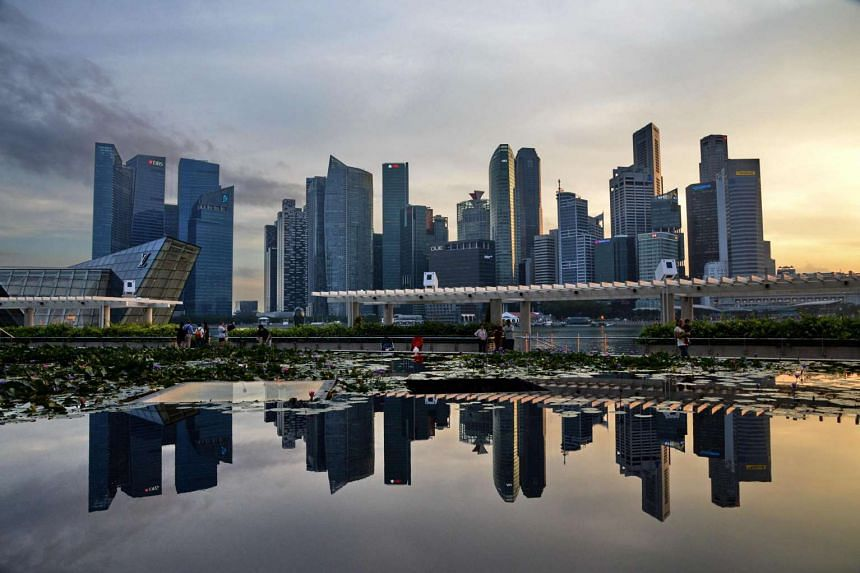A sunset over the skyline of Singapore.