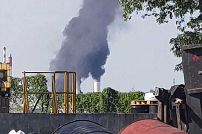 A photo of the fire taken by Straits Times reader Ben Teo. The SCDF and the in-house emergency response team of SRC, which owns the refinery, put out the fire at 11.10am. Foaming operations were also carried out.