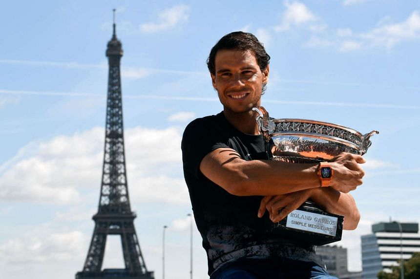 Nadal poses with the French Open trophy, June 12, 2017.