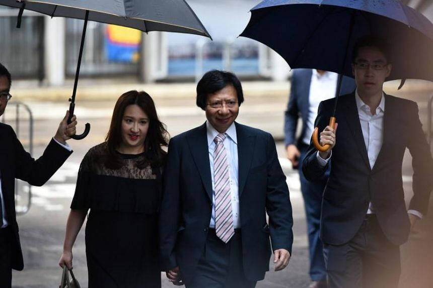 Property tycoon Thomas Kwok (centre) arrives holding the hand of his daughter Noelle at the Court of Final Appeal to receive his final appeal judgement over his corruption conviction.