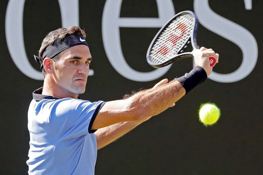 Switzerland's Roger Federer returns the ball to Germany's Tommy Haas.
