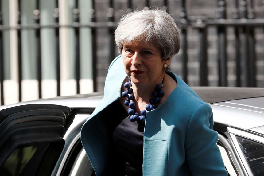 British PM Theresa May arrives in Downing Street in central London, June 14, 2017.