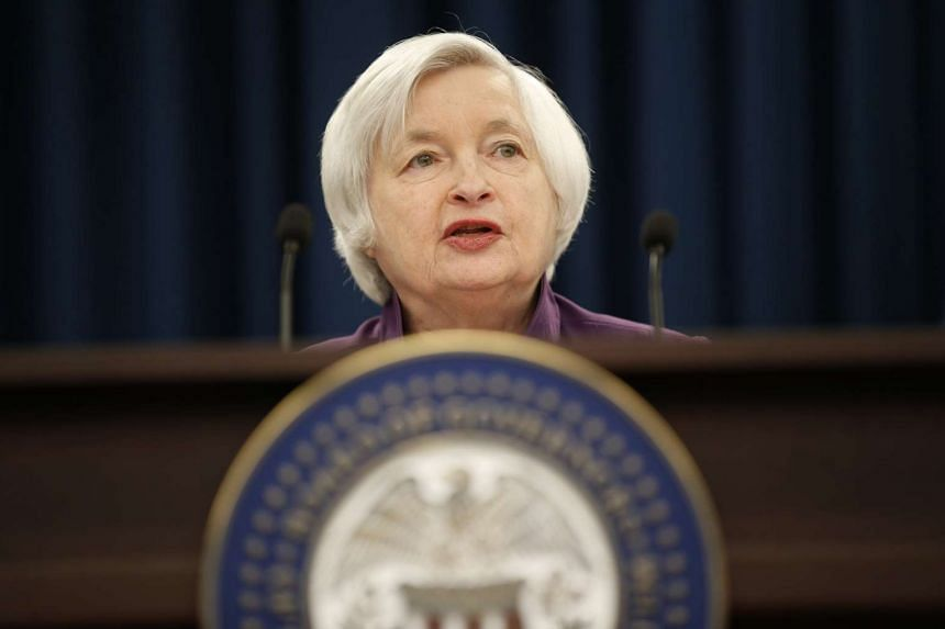 Fed chief Janet Yellen holds a news conference after the Fed released its monetary policy decision.