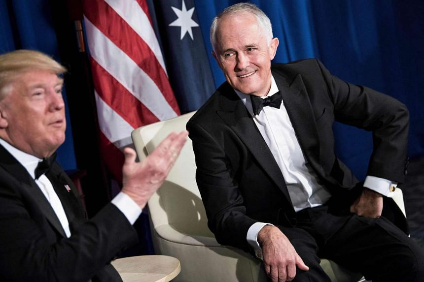 Australia's Prime Minister Malcolm Turnbull (right) listening as US President Donald Trump makes a statement to the press before a meeting on board the Intrepid Sea, Air and Space Museum in New York, on May 4, 2017.