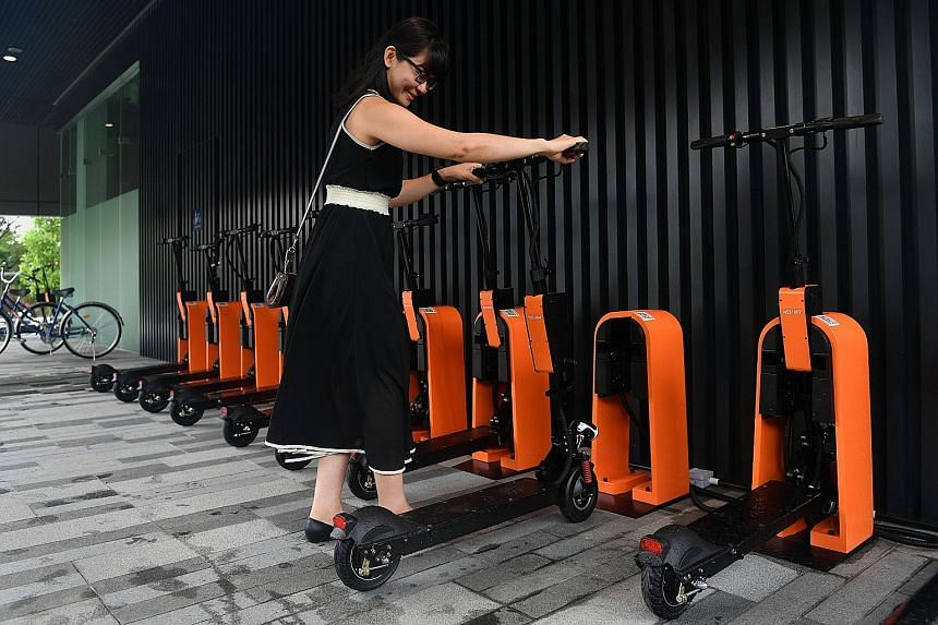 A docking station for e-scooters at Singapore Science Park 1. The devices can be located and unlocked using an app.