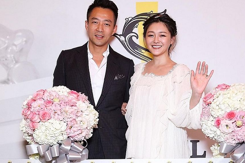 Actress Barbie Hsu and her husband, businessman Wang Xiaofei, at the opening of S Hotel in Taipei on Tuesday.