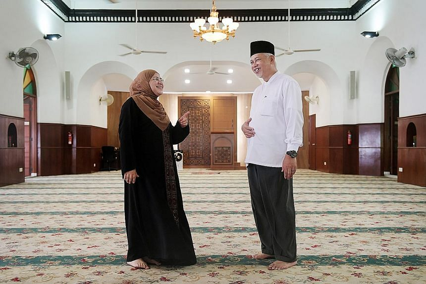 """Mr Yusoff Ali, chairman of Masjid Omar Kampong Melaka, with Ms Zahra Aljunied, a fifth-generation descendant of Arab merchant Syed Omar Aljunied, who built the mosque. """"This place is like home, for both me and others,"""" she said. Masjid Omar Kampong M"""