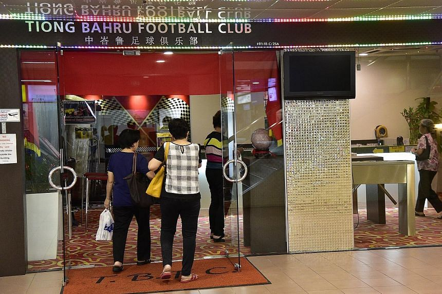 […] Patrons going into Tiong Bahru Football Club's clubhouse at People's Park Centre yesterday. [/…]It still has 29 fruit machines after a raid by the Commercial Affairs Department in April.