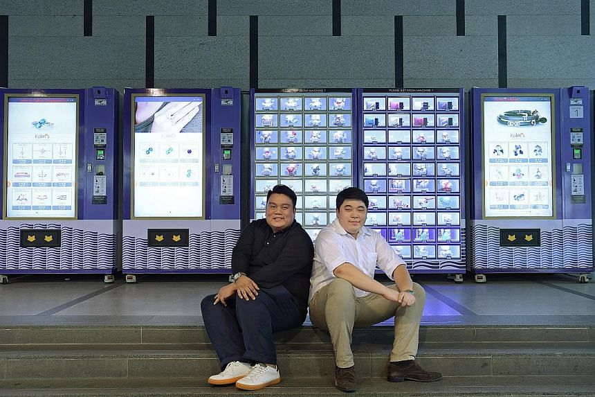 "Kalms (Singapore) chief executive Azan Tengku (left) and operations manager Masataka Mukai beside the company's cluster of ""automated retail machines"" at International Plaza."