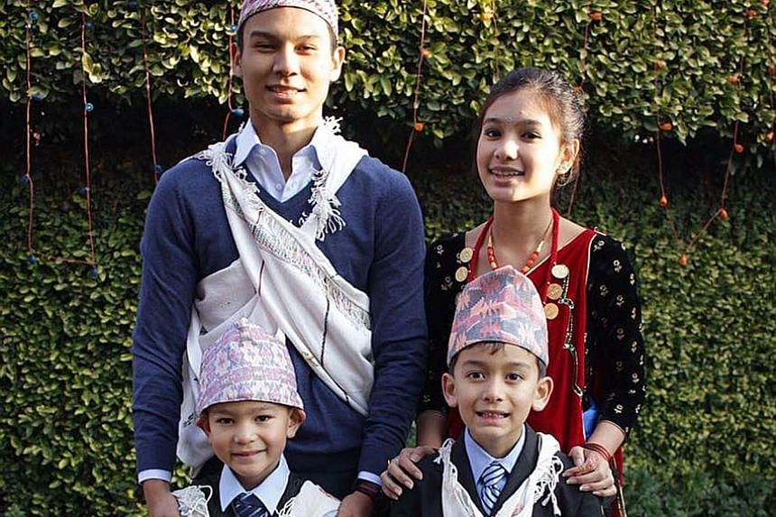 Top: Mr Prabha Khar Parajuli, 50, and his wife, Mrs Isha Parajuli, 44, own Himalayan Enterprises, which sells Nepalese goods. Left: Student Raul Gurung, 17, together with his sister Tashii, 12, and two younger cousins, wearing elements of the traditi
