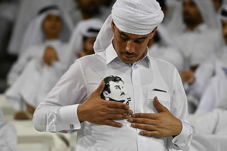 A Qatari wears his loyalty clearly with a photo of the Emir, Sheikh Tamim Hamad Al-Thani, on his shirt. The move last week by Saudi Arabia, Bahrain and the UAE to cut ties with their fellow Gulf state Qatar has resulted in confusion and consternation