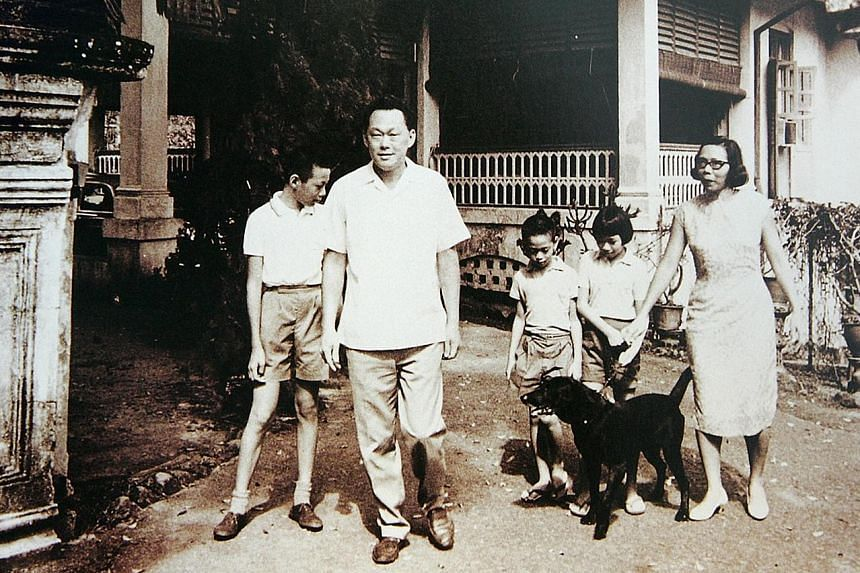 The young Lee siblings with their parents, Mr Lee Kuan Yew and Madam Kwa Geok Choo, at their home at 38, Oxley Road, which is at the centre of the dispute. The late Mr Lee stated in his will that he wished for the house to demolished.