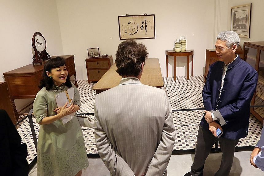 Mr Lee Hsien Yang and his wife Lee Suet Fern showing a visitor furniture and exhibits from Mr Lee Kuan Yew's house at the preview of the 2015 exhibition, We Built A Nation, at the National Museum. Mr Lee told The Straits Times yesterday that leaving