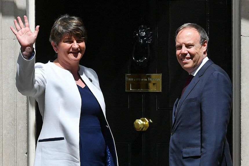 Democratic Unionist Party (DUP) leader Arlene Foster (left), and DUP Deputy Leader Nigel Dodds arriving at 10 Downing Street in central London, for a meeting with Britain's Prime Minister Theresa May on June 13, 2017.