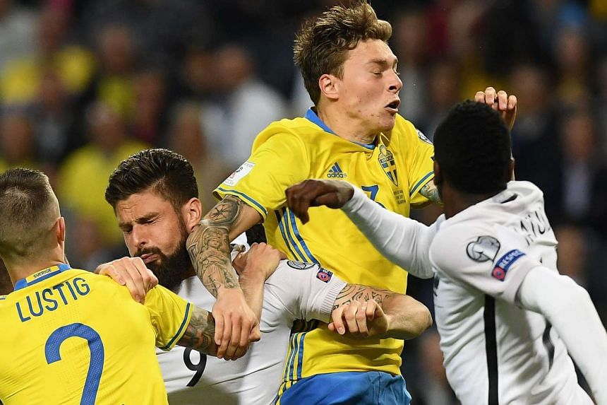 France forward Olivier Giroud vying with Sweden defender Victor Lindelof during the World Cup 2018 qualifier in Solna on June 9, as defender Mikael Lustig and midfielder Blaise Matuidi give support.