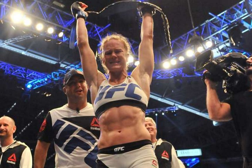 Holly Holm, who is on the main card for Saturday's fight, sees the Aug 26 McGregor-Mayweather bout as 50-50.