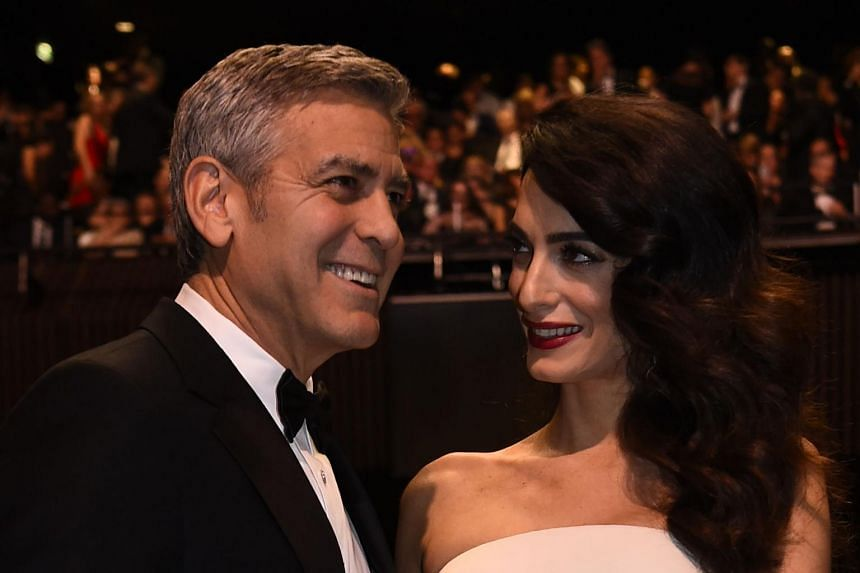 US actor George Clooney and his wife British-Lebanese lawyer Amal Clooney arriving for the 42nd edition of the Cesar Ceremony at the Salle Pleyel in Paris, on Feb 24, 2017.