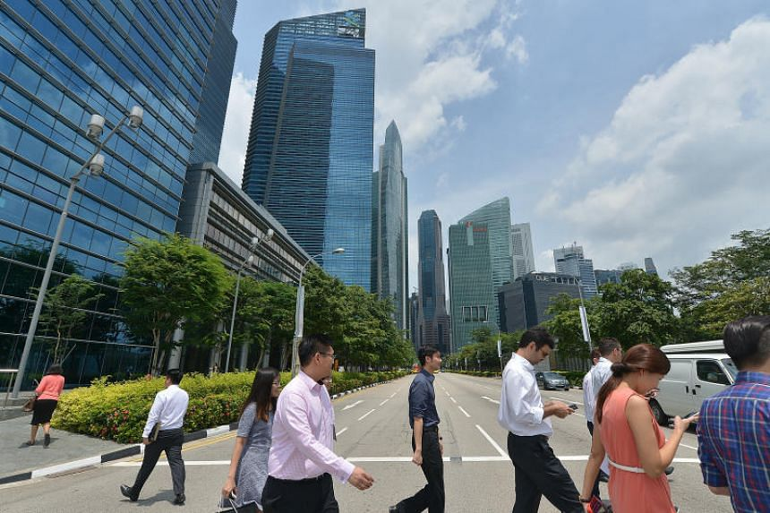 Office workers crossing the road in the central business district.