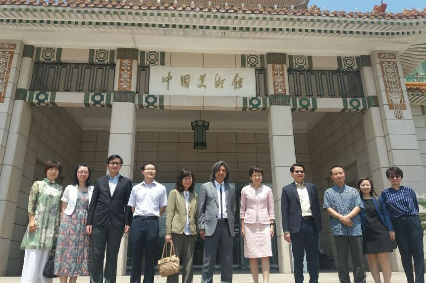National Art Museum of China's director Wu Weishan (sixth from left), Minister for Culture, Community and Youth Grace Fu, and representatives from Beijing and Singapore, in front of the National Art Museum of China.