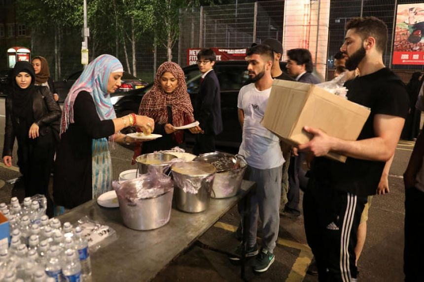Food distributed near a tower block severely damaged by a serious fire in West London.