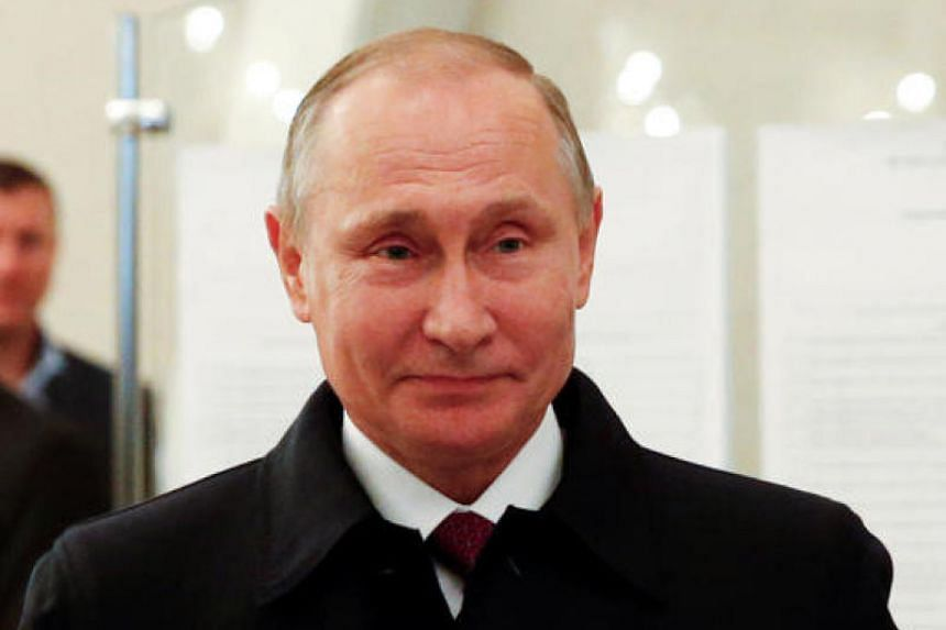 Vladimir Putin visiting a polling station during a parliamentary election in Moscow, Russia, on Sept 18, 2016.