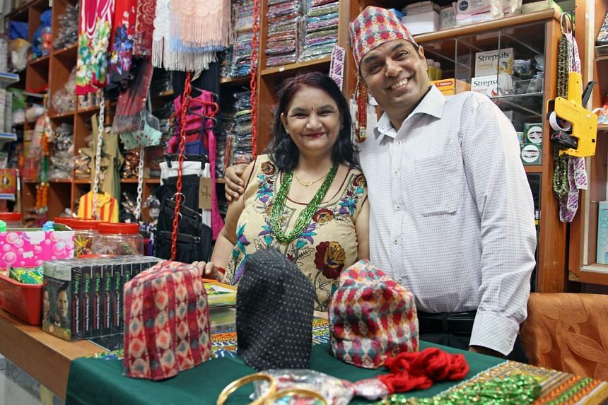 Mr Prabha Khar Parajuli, 50, and his wife, Mrs Isha Parajuli, 44, own Himalayan Enterprises, which sells Nepalese goods.