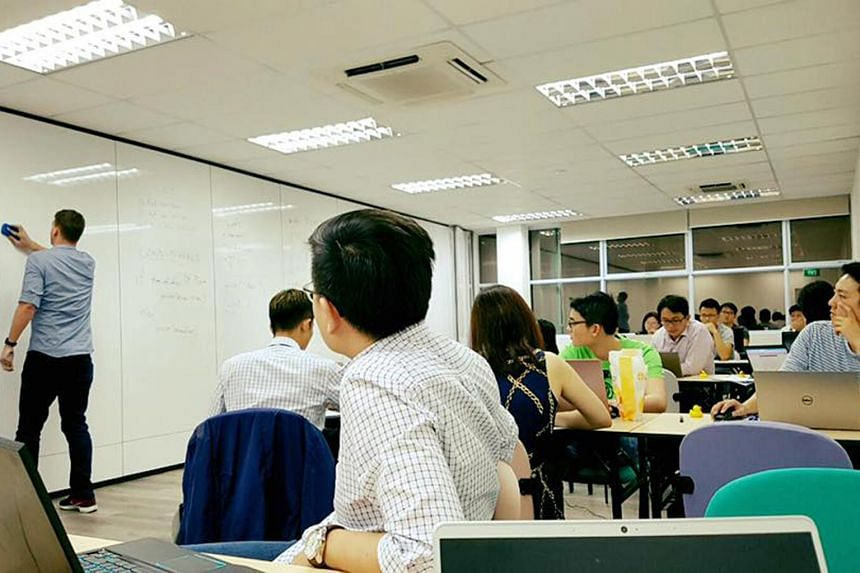 A programming class at Byte Academy Singapore last December. The school had aimed to groom up to 2,000 financial technology and data science programmers in Singapore.