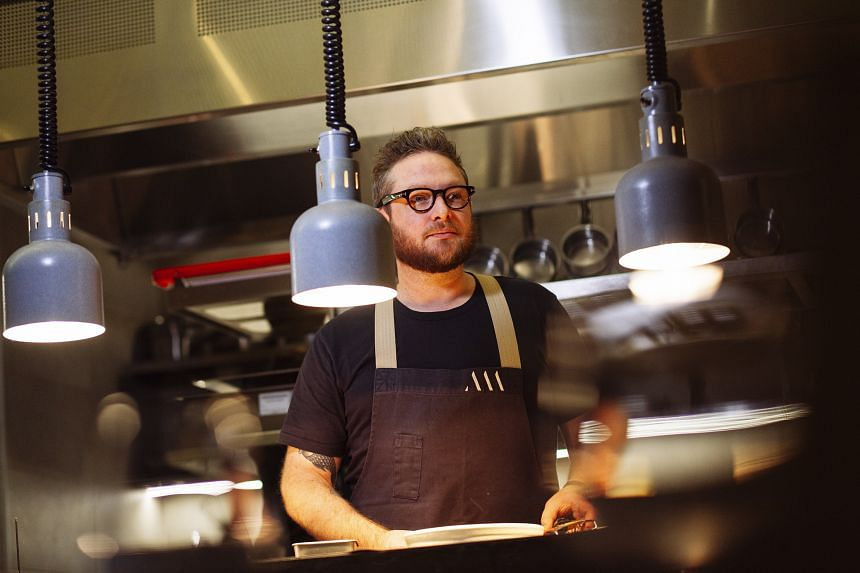 Clayton Wells cooks at his restaurant Automata in Sydney.