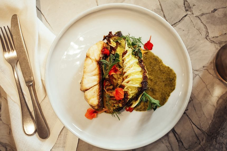 Grilled wild barramundi with savoy cabbage, laver and lemon at Fred's.