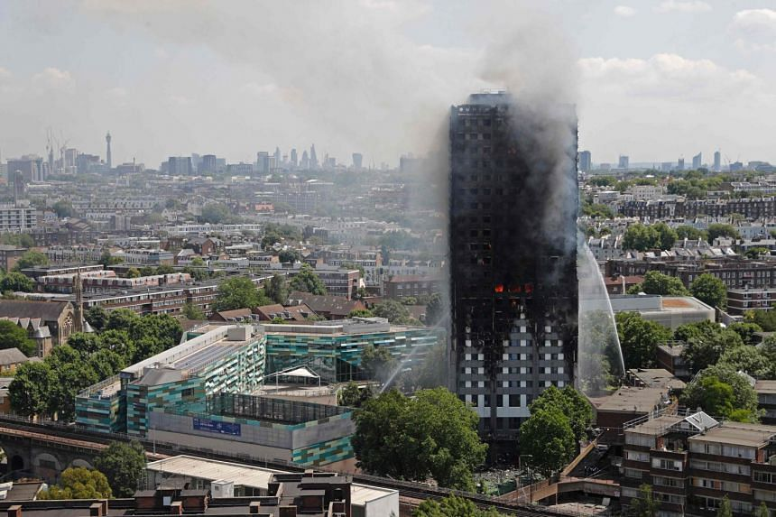 Smoke and flames billows from Grenfell Tower as firefighters attempt to control the blaze in west London, on June 14, 2017.